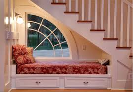 reading nook under stairs with drawer storage and backyard view ideas