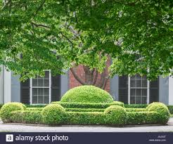 Hamptons Home An Elaborate Hedge In Front Of A Hamptons Home Stock Photo