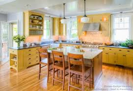 yellow kitchen ideas traditional yellow kitchen with a custom wood island