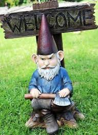 grinchy rude angry gnome with axe welcome statue home greeter