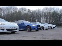 bmw vs audi race drag race bmw m5 v porsche panamera s v mercedes e63 amg v jaguar