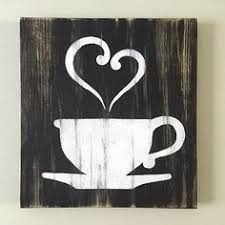 wood coffee sign with but coffee written five hooks