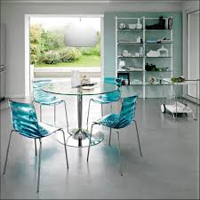 furniture blue acrylic chairs coupled with round glass table with