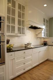 black kitchen cabinets with white subway tile backsplash the classic of subway tile backsplash in the kitchen