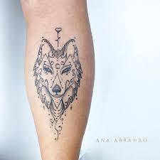 mandala wolf tattoo on back leg