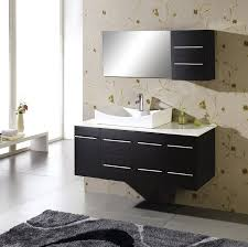 black floating bathroom vanity with white sink on it connected by