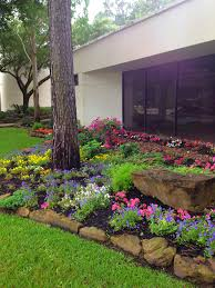 landscape design with beautiful moss rock borders boulder and
