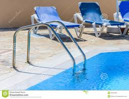 Swimming Pool Canopy by A Swimming Pool With Sun Loungers Royalty Free Stock Photography