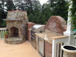 outdoor kitchen designer blends bricks with stone to mesh the