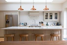 organize kitchen ideas sleek wooden stools and copper finished pendant ls for organized