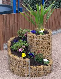 ivory stone planter box with plant and flowers for outdoor