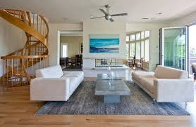 area rugs for living rooms contemporary living room with ceiling fan by sea island builders