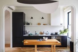 small streamlined brooklyn kitchen with black cabinets by