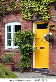 brick house front door yellow front door entrance old style stock photo 133833371