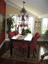 suede dining room chairs wrought iron chandelier above espresso wooden dining table on