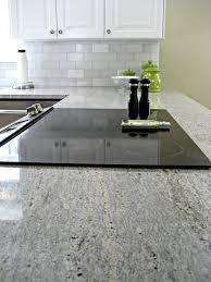 gray kitchen cabinets with white granite kashmir white granite countertops 25 ideas for the kitchen