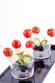 healthy canapes dinner cheese and olive canapes with tomato and cucumber stock photo