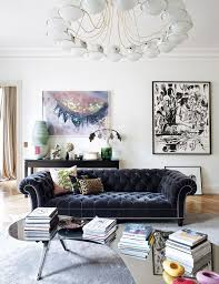 deep blue velvet sofa a refined parisian apartment blue velvet sofa chandeliers and flats