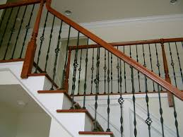 steel ornamental balusters with wood handrail traditional