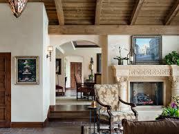 clerestory windows leather ottoman wood burning fireplace