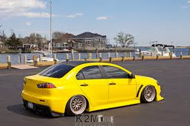 cars mitsubishi lancer car yellow cars mitsubishi lancer evo x wallpapers hd desktop
