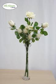 realistic cream roses in glass vase arrangement