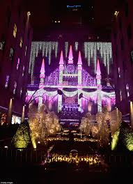 rockefeller christmas tree lights up and officially kicks off the