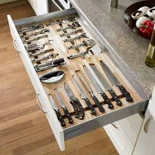 modern kitchen with drawer knife storage and white cabinets