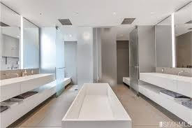 modern master bathroom with limestone tile floors u0026 built in
