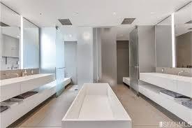 modern master bathroom with limestone tile floors u0026 built in