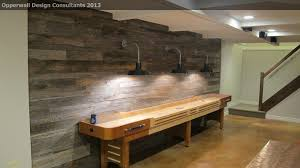 reclaimed wood game table shuffleboard table in basement farmhouse with barn wood wall next to