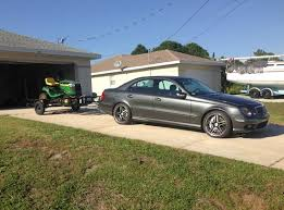mercedes towing nissan 350z versus mercedes e55 amg towing a lawnmower who