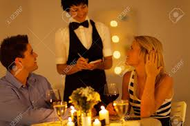 place dinner order to waitress in a restaurant stock
