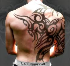 men tribal tattoo design on arm sleeve and back tattoomagz