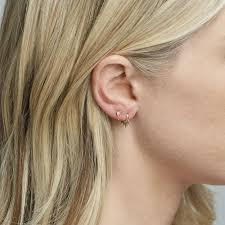 hoop huggie aj 14k gold crown hoop huggie earrings iconery