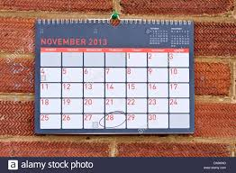 monthly calendar hung on a wall with thursday 28th november