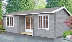 national parks protected land keops interlock log cabins gardenlife s deben log cabin painted in pale green and brown cabin