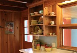 a knotty pine kitchen respectfully retained and revived retro