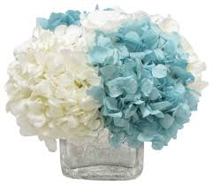 white floral arrangements cracked glass cube white hydrangea blue and white