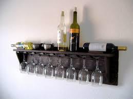 black wood wall mounted wine rack with eight glass wine racks on