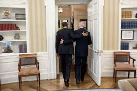 in this photo of obama and biden leaving the oval office there