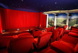 home movie theaters luxury movie theater for home with red silk seating ideas