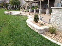 Cutting Edge Lawn And Landscaping by Sandstone Setts Used As Lawn Edge And Define Planting Areas