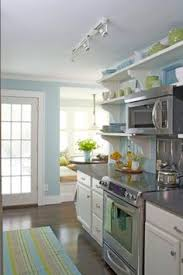 Replace Kitchen Cabinets With Shelves by Editors U0027 Picks Our Favorite Cottage Kitchens Glass Cabinet