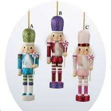 glitter nutcracker ornament holding lollipop