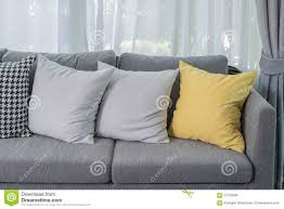 Living Rooms With Grey Sofas by Yellow Pillow On Grey Sofa In Modern Living Room Stock Photo