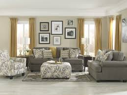 living room design of living room carpet grey sofa cushions pouf