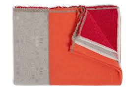 shades or orange achieve maximum cosiness at home with blankets cushions and