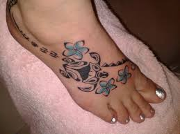 blue flowers and polynesian turtle tattoo on right foot