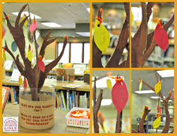 make a tree out of cardboard and cut out leaves from construction